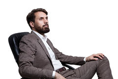 Isolated businessman sitting side Royalty Free Stock Images