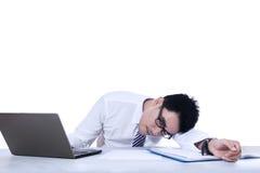Isolated businessman sleeping Stock Photography