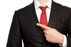 Isolated businessman in a suit points the finger at an object Royalty Free Stock Photos