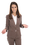 Isolated businesswoman in brown presenting and showing with hand Stock Image