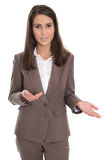 Isolated businesswoman in brown presenting and showing with hand Royalty Free Stock Photography