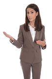 Isolated businesswoman in brown presenting and showing with hand Royalty Free Stock Images