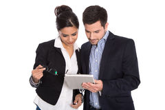 Isolated businesswoman and businessman looking at tablet pc. Stock Image
