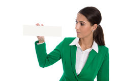 Isolated businesswoman in green holding white billboard in her h Stock Photography