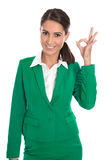 Isolated businesswoman in green making excellent gesture with fi Stock Photo