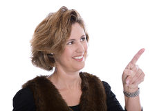 Isolated businesswoman in winter clothes presenting with her for Stock Photo