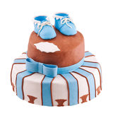 Isolated cake with baby bootee. Isolated striped cake with baby bootee Stock Image