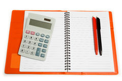 Isolated calculator, notebook and pen Stock Photography