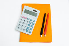 Isolated calculator, notebook and pen Stock Photos