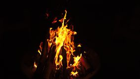 Isolated Camp Fire Flames and Logs Burning. Isolated Camp Fire with Flames and Logs Burning Black Background Royalty Free Stock Photos