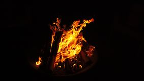 Isolated Camp Fire Flames and Logs Burning. Isolated Camp Fire with Flames and Logs Burning Black Background Royalty Free Stock Images