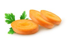 Isolated carrots. Carrot slices and parsley isolated on white background, with clipping path stock photo