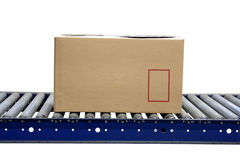 Isolated carton on conveyor rollers royalty free stock photos