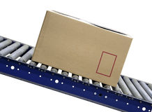 Isolated Carton on conveyor rollers Royalty Free Stock Images
