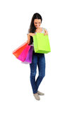 Isolated casual woman. Isolated young casual woman looking bag Royalty Free Stock Photos