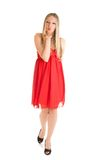 Isolated caucasian blond woman in red dress Stock Photography