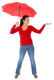 Isolated Caucasian Woman In Red Holding Umbrella. Caucasian woman in red holding umbrella protecting herself from rain royalty free stock photography