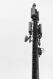 Isolated cellphones network antenna. Isolated vertical cellphones network antenna Stock Photography
