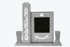 Isolated cement and white mosaic tombstone Royalty Free Stock Photo