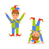 Isolated character in jester costume. April Fools Day. Joker standing with arms raised and standing on his head Royalty Free Stock Photos