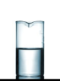 Isolated chemical beaker on table with solution Royalty Free Stock Images