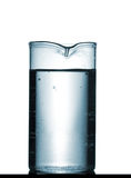 Isolated chemical beaker on table with solution Stock Photo