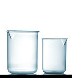 Isolated chemical plastic beakers on table Stock Images
