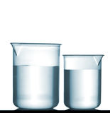 Isolated chemical plastic beakers on table with solution Stock Photography