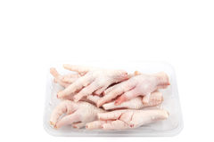 Isolated of Chicken Feet on Plastic Plate. And White Background Royalty Free Stock Images
