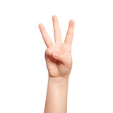 Isolated child hand shows the number three. Isolated child hand shows the number  three Stock Photography