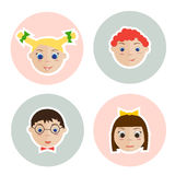 Isolated children faces. Isolated children faces on the circle. Two little girl and two boy Stock Photos