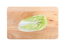 Isolated chinese cabbage on wooden chopping board Royalty Free Stock Photography