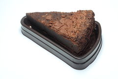 Chocolate cake. An isolated brown chocolate cake Royalty Free Stock Images