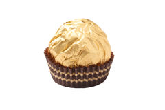 Isolated chocolate candy wrapped in golden foil Royalty Free Stock Images