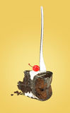 Isolated Chocolate cherry cake with fork from back on yellow background. Stock Photos