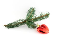 Isolated christmas decoration on white background. (Twig and red heart royalty free stock photo