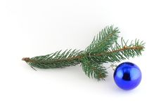 Isolated christmas decoration on white background. (twig and blue ball Stock Image