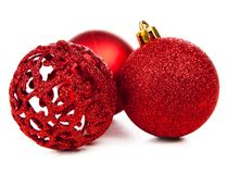 Isolated Christmas ornaments. Three isolated red Christmas ornaments stock photos