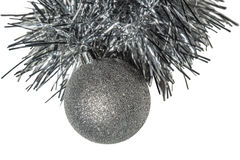 Isolated Christmas silver tree toy with tinsel on a white background. Royalty Free Stock Photo