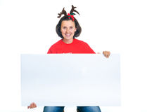 Isolated christmas woman looking at a blank sign Royalty Free Stock Photography