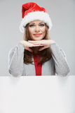 Isolated Christmas woman portrait with white card Royalty Free Stock Photo