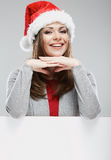 Isolated Christmas woman portrait with white card Royalty Free Stock Image