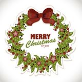 Isolated Christmas wreath with greetings on the paper background Stock Photos