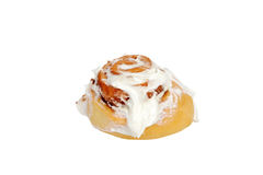 Isolated cinnamon bun with icing Royalty Free Stock Images