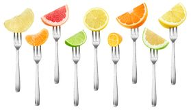Isolated citrus pieces on forks collection Royalty Free Stock Image