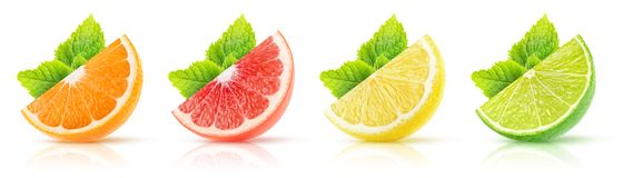 Isolated citrus wedges collection. Isolated citrus fruits collection. Wedges of orange, pink grapefruit, lemon and lime with mint leaves on white background with royalty free stock photos