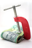 Isolated Clamped Paper Money Stock Photo