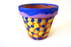 Isolated clay flower pot. Clay flower pot painted in blue and yellow polls dots Stock Images