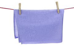 Isolated Clean Dry Violet Towel Hanging On A Red Rope Royalty Free Stock Images