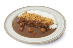 Isolated and clipping path of Japanese curry rice with tonkatsu. Tonkatsu : Deep Fried Pork Tenderloin Royalty Free Stock Photo